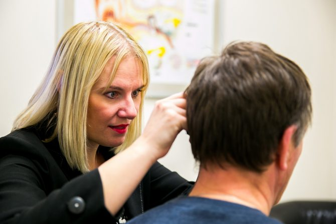 Sarah undertaking microsuction ear wax removal in Nottingham